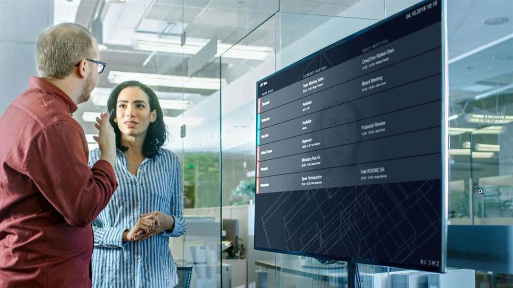 Die Lösung für eine digitale Meetingraum- und Arbeitsplatzorganisation von Roomz. Abbildung Roomz